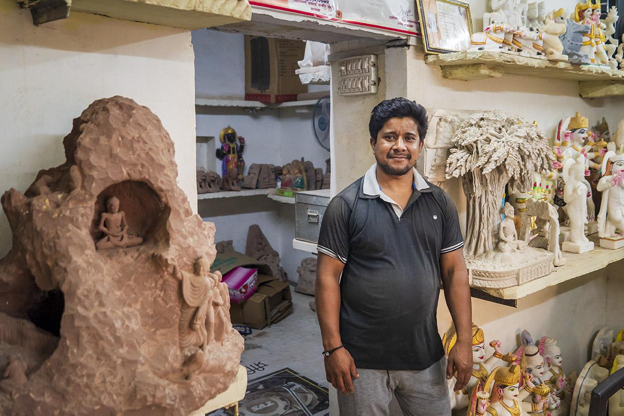 Satish Vishwakarma with his award-wining works on the life of Lord Buddha