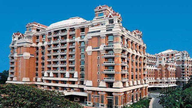 091214134230-facade-itc-grand-chola-ch